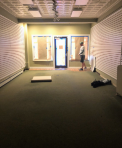 This space was a former stationery store and needed quite a bit of renovation before it opened. Here is a photo just before work began.