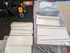 Brandon opens another box to find all the drawer parts - labeled and well organized. Everything was designed to be simple and straightforward to install, reinstall, and adjust as storage needs change.