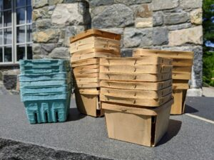 We use both wood berry boxes and the fiber pulp berry boxes when harvesting. They have slotted sides for ventilation and are also eco-friendly.