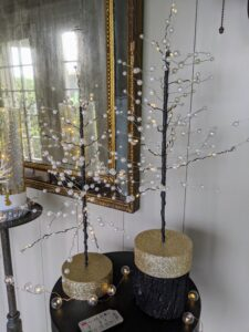 These are my Pre-Lit Pearl Trees. These 16-inch illuminated trees come in a set of two. Each of the branches is decorated with pearl beads and warm white LED lights. They can be used alone or together on your table or mantel.