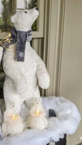 I love this whimsical scarf-wrapped fun and furry polar bear. It adds a playful accent to seasonal decor. This standing figure is 23-inches tall and 10-inches wide. I also offer a sitting polar bear. They can be used together or apart.