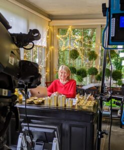 """Since it's still so important to follow social distancing guidelines as best we can, our """"Christmas in July"""" show was done remotely, and with a very small crew. We filled my home porch with all my newest holiday decorations and joined QVC host, Alberti Popaj, via Skype. Here I am at my desk just as the broadcast began."""