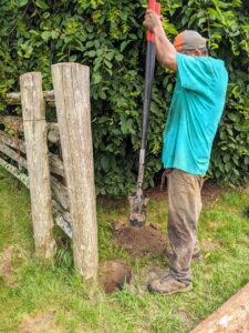 Pete replaces two more wobbly posts that flank the fence gate.