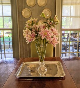 This arrangement sits on a dining table between my servery and my foyer. It looks great on this silver platter.