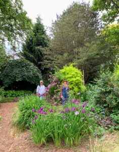 "It was great to see Dennis. Here we are in one of the gardens - keeping a safe distance apart. We are surrounded by Jasmine 'Fiona Sunrise,' Rosa 'Veilchenblau' ""Blue Rambler Rose,"" and Japanese Iris."