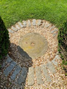 This is the step down to the lawn area made from an old millstone. I love these antique millstones and also have a few at my farm.