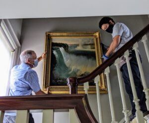 It was the perfect location for this Niagara Falls painting. It's hung high enough so that it is not blocked by the banisters when looking at it from the first floor - another important consideration when hanging.