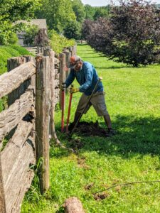 Pete dug around the posts by hand using a post hole digger, a hand tool used to manually dig deep and narrow holes in order to install fence posts. A post hole digger is also known as a clamshell digger, because of its resemblance to the seaside shell.