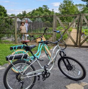 Here's a fun snapshot of Kevin and me from inside the vegetable garden with our e-bikes parked just feet away.