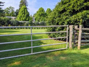 I have many gates leading into the various paddocks around my farm. This one, between my party lawn and orchard, needed some repair. The posts no longer supported the gate as well as it should and the gate slanted downward rubbing against the grass.