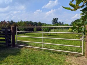 Pete also makes any necessary adjustments, so the gate is level at both sides and from the bottom. Here's the finished fence gate - it looks terrific.