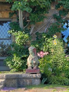 "The sphynx is out ""guarding"" the terrace for the season. She is one of two glazed terra-cotta sphinxes I have designed by Emile Muller."