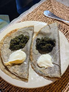 I love blinis topped with caviar and creme fraiche.
