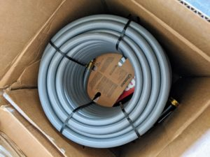 The Gilmour 50-foot and 100-foot Flexogen hoses are heavy-duty eight-ply garden hoses with a polished surface that resists abrasions, stains, and mildew. I have these hoses all over the farm.