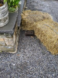 Chhiring uses two bales to ensure the water goes directly into the drain.