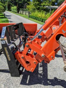 The fork is removed from the tractor and replaced with the Kubota front loader bucket.