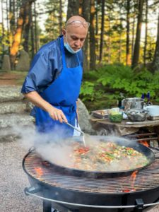Here is Chef Pierre cooking up a large pan of paella. For even cooking, it's important to use a traditional paella pan, which is round and flat with shallow sides. Paella is one of my favorite summer meals to cook for guests.