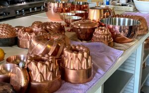 I display lots of copper pieces in my kitchen. Here are some of the copper molds I keep on the lower island shelves. They were just removed from the shelves, so they could be cleaned. Copper was actually one of the first metals used by humans more than 10-thousand years ago, and it remains a common household material today. Polishing copper, silver, brass, or any other metal a few times a year is generally sufficient to keep it in good condition.