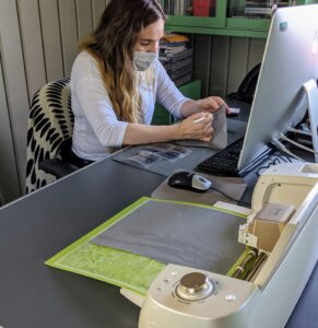 The Cricut sits comfortably on Shqipe's desk. Be sure there is ample room in front and in the back of the machine, so the paper can be fed easily.