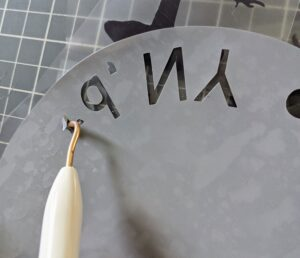 After the Cricut has finished cutting, the cuts can easily be removed using the weeder tool. If the cuts are wider, the spatula tool works very well for this also.