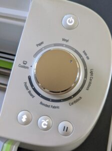 The button panel to the right is well labeled for each step of the cutting process.