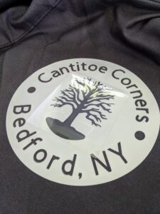Once it cools, Shqipe places the layered sycamore tree onto the center of the decal.