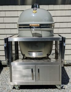 This is my Grill Dome. I love this grill - the round shape provides even heat distribution while the thick ceramic walls hold in the heat. Plus, you can have it custom colored – of course, I chose the color closest to my signature Bedford Gray.