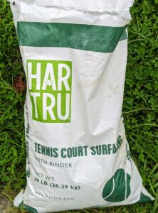 HAR-TRU is crushed igneous rock which provides a softer surface preferred by many tennis players. It offers less impact, less fatigue, and slower play. The amount of HAR-TRU needed for a one-inch layer is 11 pounds per square foot. Two tons of HAR-TRU are needed to cover an entire regulation tennis court.