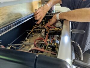 Donald starts with some regular cleaning on my La San Marco espresso machine. Any commercial-grade espresso machine should be back-flushed every day to reduce oil and residue build-up.