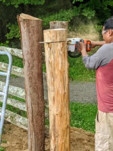 Next, Pete cuts the post top, so it is just a bit higher than the topmost railing. Pete uses our STIHL chainsaw. This one is run on an AP 300 S Lithium-Ion Battery, which is powerful and compatible with a wide range of other STIHL tools. This post should last another 15-years or more. It is made of cedar. Cedar is extremely durable and holds up well to outdoor weather conditions.