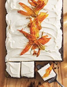 This book is divided by type with this Chocolate Zucchini Cake in our sheet cake chapter. It's a deliciously moist cake you can bake ahead. To make it even more special - use candied zucchini blossoms to decorate the top. (Photo by Lennart Weibull)