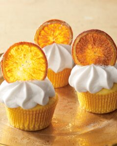 Also in this book - Orange Curd Cupcakes. These cupcakes are filled with delicious citrus flavor. They're made using zest in the batter, curd in the filling and fresh slices of fruit on top. (Photo by Mike Krautter)