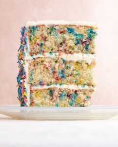 "Our Sprinkle Cake is a big favorite in our Celebration Cakes section. No birthday party should be without one - complete with three cake layers and homemade ""confetti"" sprinkled inside and out. (Photo by Lennart Weibull)"