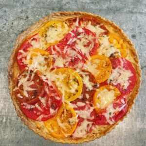 On another day, this tomato tart made with pâte brisée, roasted garlic, garden tomatoes, thyme and Gruyère cheese.