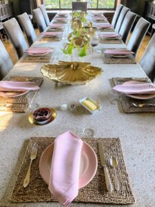"""My dining room at Skylands is used often during my visits to Maine - the long table can accommodate all my family and friends. There is this long table, and a smaller one at one end for any extra """"mouths to feed."""" And the table is always set - a little differently each time."""