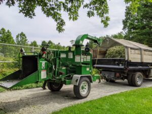 I am fortunate to have my own wood chipper, a machine with sharp moveable blades that can cut wood up into small pieces. Branches, as well as underbrush, and other old plantings, can all run through the chipper – everything is returned to the earth, organically and efficiently.
