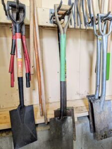 Here are some of the short-handled spades. Do you know the difference between a shovel and a spade? Shovels are broad-bottomed tools for moving loose materials, while spades tend to have a flat bottom edge for digging.