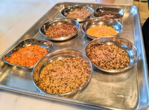The food dishes are filled with a variety of seed mixes. I am always looking for the best, most nutritious seeds I can find to keep my birds healthy. I provide multiple feed bowls with a buffet of seeds along with all their fresh vegetables and fruits.