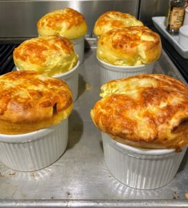 On another night, we enjoyed these delicious Gruyere cheese souffles, perfectly fluffy, browned and fresh from the oven. Gruyère is a hard yellow Swiss cheese that originated in the cantons of Fribourg, Vaud, Neuchâtel, Jura, and Berne in Switzerland. It is sweet but slightly salty, with a flavor that varies widely with age.