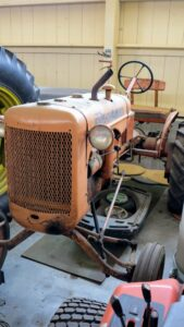 I also have this vintage Allis-Chalmers tractor from the 1940s. It reminds us how much these farm pieces have evolved over the years.