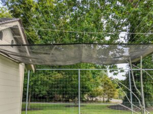 Here is the shade cloth fully extended. It will offer the most shade in the morning sun, but will provide another nice area for the peafowl to rest.