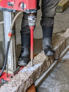 A core drill can penetrate various surface types. It can cut cement, wood, rocks, ice, and of course, granite. It pushes through the surface with a twisting motion to create the hole.