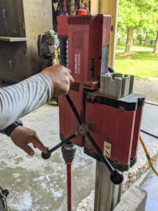 Chhiring controls the drill from above and watches the drilling very carefully to make nothing goes wrong.