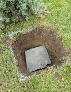 A flat stone is placed at the bottom to prevent any shifting or sinking over time.