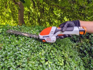 He's using our STIHL HSA 25 Battery-Powered Garden Shear. It's lightweight with a rubberized handle for user comfort and a secure grip. It comes with its own roll-up case to store all its accessories. The hedge shear attachment with double-sided cutting blades cut both directions. It's one of our favorite tools - it's very light and handy. Check out my Instagram page @MarthaStewart48 for a video of me using this great tool.