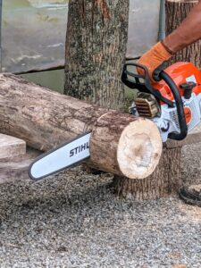 Pasang trims any logs with our trusted STIHL chainsaw. Whenever using a chainsaw, always be sure it has a sharp chain, a full tank of oil and gas, and that the operator is wearing the proper safety gear.