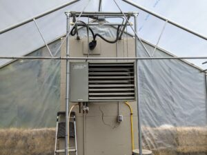 The large heater is at the back of the hoop house. During winter it is checked a couple times each day to make sure the temperature remains comfortably warm inside. Too cold, plants will freeze – too hot, plants will rot. When it is filled, this greenhouse is always kept above 50-degrees Fahrenheit.