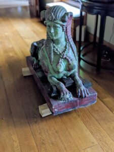 "This sphynx is now indoors ""guarding"" the living room for the season. She is one of two glazed terra-cotta sphinxes I have designed by Emile Muller."