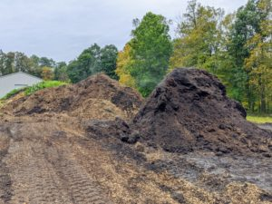 In this area, I also have several piles of organic material in different stages of decomposition - mulch, leaf mold, and manure. It will all be ready to use after it is mixed together, turned and then sieved through the grinder.