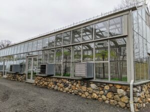The greenhouse is equipped with heavy-duty aluminum vent systems that automatically open and close when needed to allow hot air to escape while simultaneously allowing fresh air into the space.